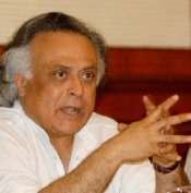 Environment Minister Jairam Ramesh speaks with members of the Chinese delegation.