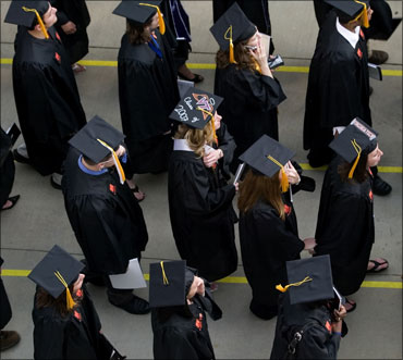 Students make their way to the university commencement ceremony.