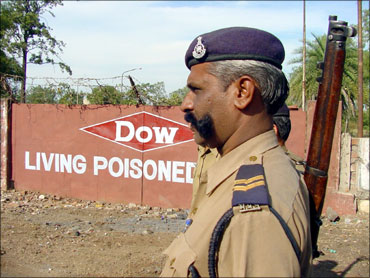A policeman stands outside the Union Carbide factory in Bhopal.