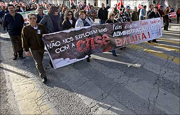 Portuguese workers hold a banner, 'Don't explore us more with crisis'.