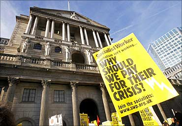 Anti-capitalist student protestors demonstrate outside the Bank of England in London.