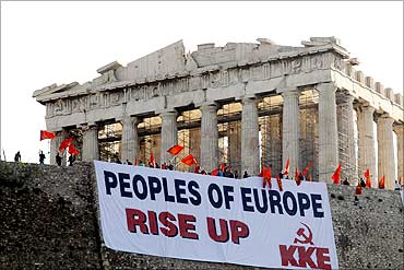 A giant banner protesting Greece's austerity measures.