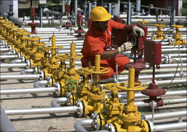 An engineer of Oil and Natural Gas Corp works inside the Kalol oil field in Gujarat.