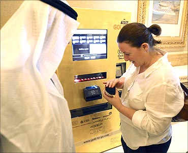 Customers use a gold-plated ATM machine.