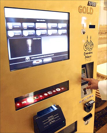 A man uses the ATM at the Emirates Palace Hotel in Abu Dhabi.