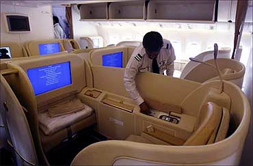 An official looks at the first class cabin section in Air India's new Boeing 777-20.