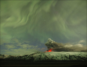 The Northern Lights are seen above the ash plume of Iceland's Eyjafjallajokull volcano.