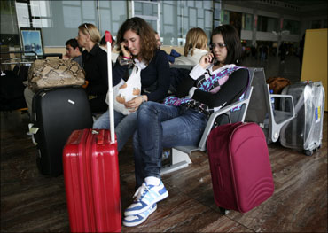 People wait at the Prat Airport in Barcelona. Fifteen airports in Spain were closed.
