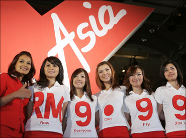 Malaysian budget carrier AirAsia stewardesses.