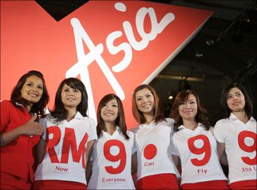 Malaysian budget carrier AirAsia stewardesses.