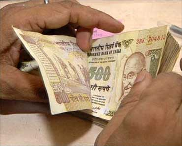 Rupee gains 20 paise to end at 55.11 vs USD