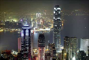 aHong Kong's financial district is lit up.