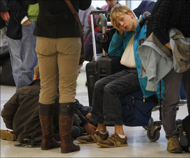 Harried tourists stranded at an airport in UK.