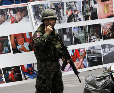 A Thai soldier patrols the streets of Bangkok.