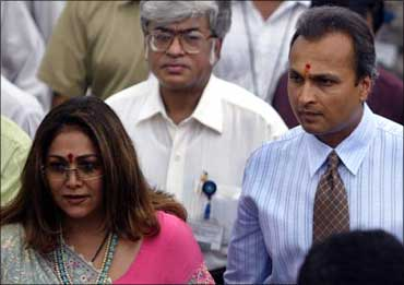 Anil Ambani and his wife Tina (L) enter the campus of group company Reliance Infocomm.