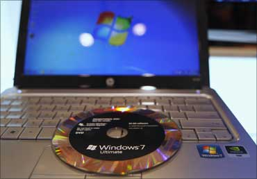 The new Windows 7 operating system installation DVD is pictured on a notebook.