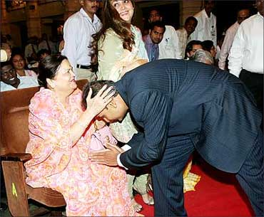 Anil Ambani seeks the blessings of his mother, Kokilaben. Also seen in the picture is Anil's wife Tina Ambani.