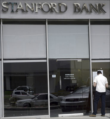 A man reads a notice outside a Stanford Bank branch in Panama City.