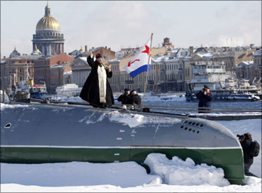A priest sanctifies a C189 submarine, the first Russian private submarine museum, in St. Petersburg.