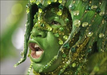 A reveller dances during the Carnival parade in Rio de Janeiro, Brazil.