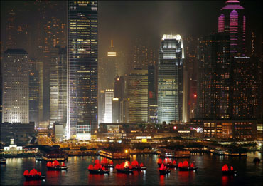 Illuminated boats float on Hong Kong's Victoria Harbour.