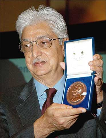 Wipro chairman Azim Premji poses with the Faraday Medal.
