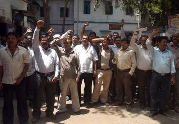 Striking Air India employees raise slogans.