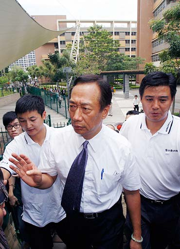 Taiwanese tycoon Terry Gou, founder of Foxconn, visits a residential area of a Foxconn factory.