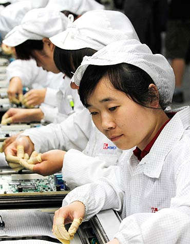 Workers are seen inside a Foxconn factory in the township of Longhua in Guangdong.