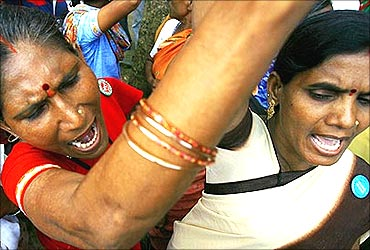 Women shout slogans during a demonstration by people displaced by proposed SEZ near Mumbai.