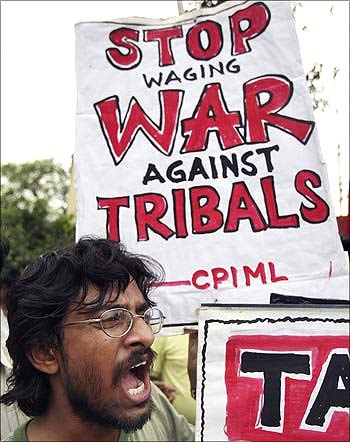 An activist of Communist Party of India (Marxist-Leninist) shouts anti-government slogans.