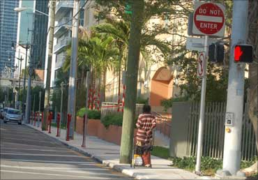 Alex Smith with his belongings at a street corner in Miami.