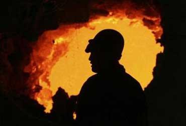 A worker in a steel factory.
