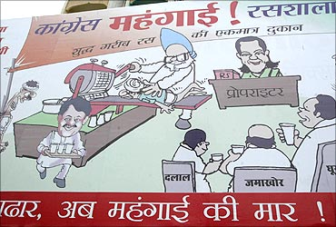 A billboard installed by India's main opposition Bharatiya Janata Party (BJP) against inflation during the rule of UPA.