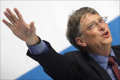 Bill Gates gestures during a news conference in Vienna.