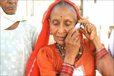 A rural woman talking on her phone.