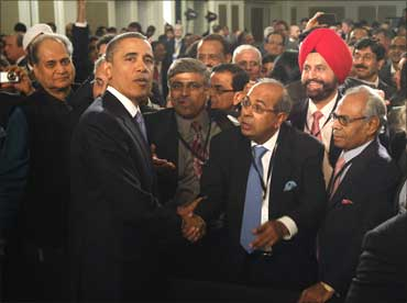 Barack Obama meets members of the audience after delivering his speech.