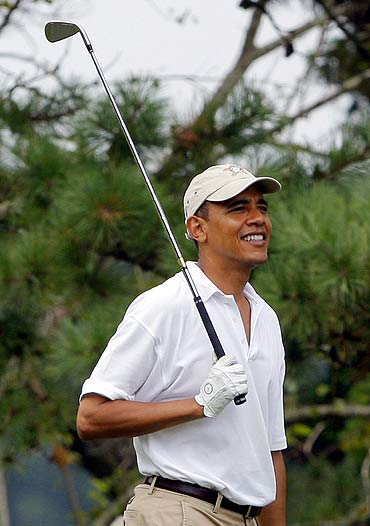 Barack Obama playing golf.