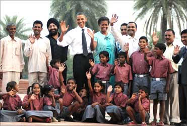 The Obamas with the school children of traditional artisans who carried out renovation works at Humayun Tomb.