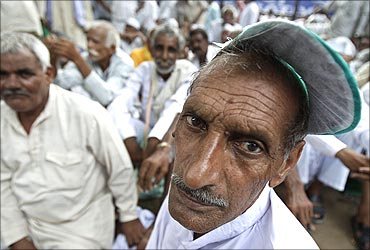 Farmers attend a protest in New Delhi.