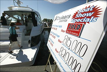 Visitors tour a motor yacht for sale at the United States Powerboat Show in Annapolis, Maryland.