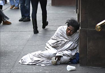A panhandler begs for money on Fifth Avenue in New York.
