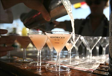 A bartender pours martinis on a yacht at the United States Sailboat Show in Annapolis, Maryland.