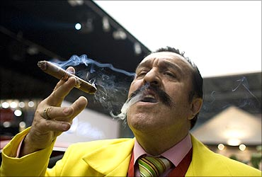 A man smokes a cigar during the opening night of the Millionaire Fair in Moscow.