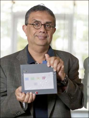 Rice University computer scientist Krishna Palem with an I-slate prototype.