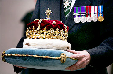 The Scottish Crown Jewels are carried by the Duke of Hamilton.