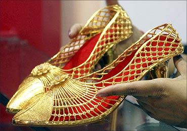 A pair of gold footwear at the 'Gem and Jewellery India International Exhibition 2010' in Chennai.