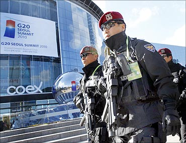 Armed policemen patrol outside a venue of the G20 Seoul Summit in Seoul.