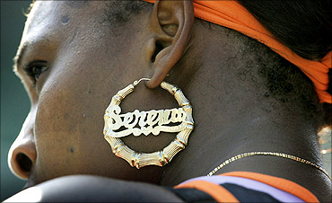 Serena Williams wearing a dazzling gold earring.