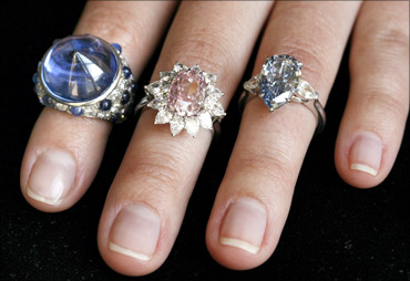 A model displays rings.
